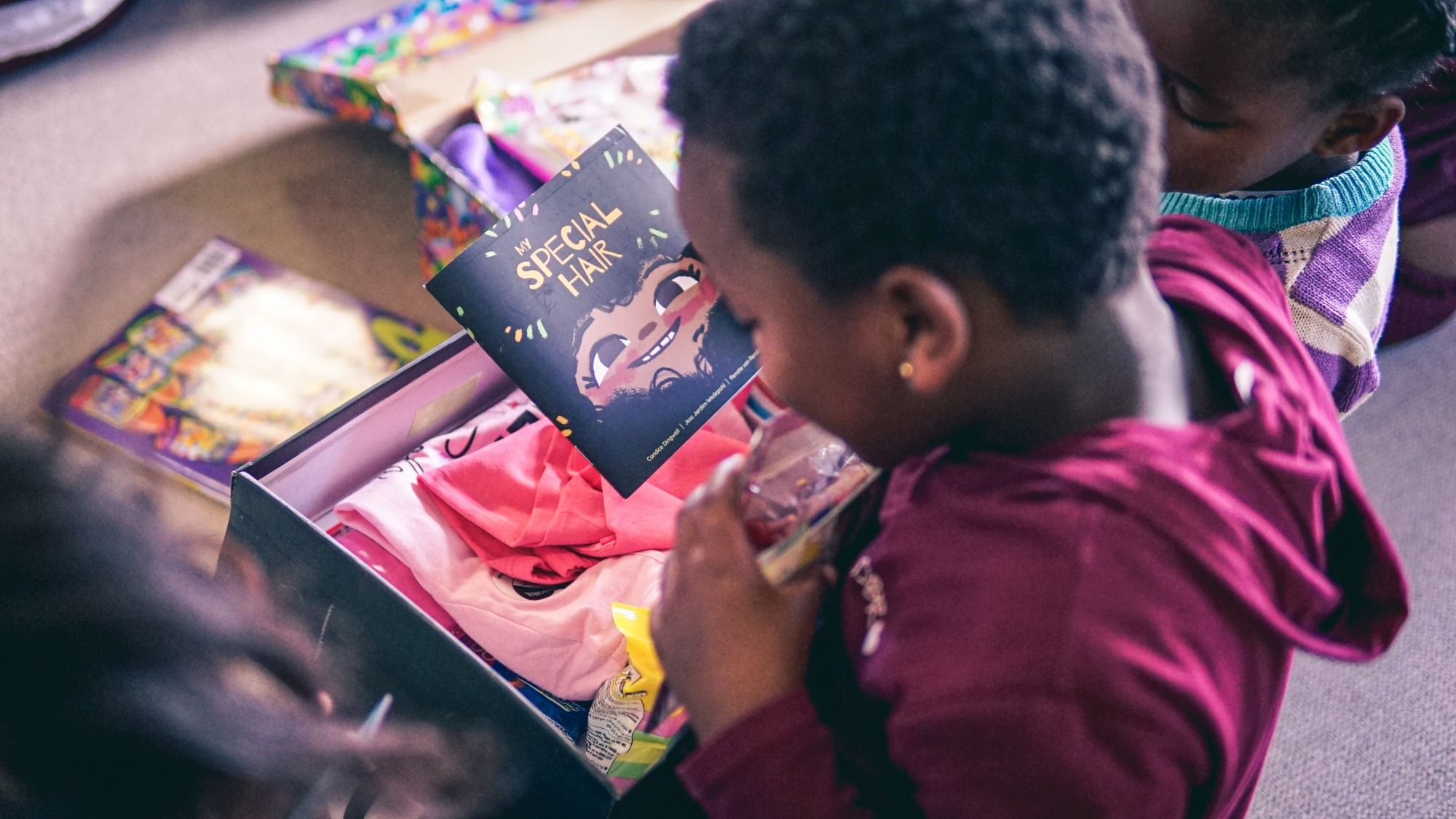 MySchool MyVillage MyPlanet Teams Up With Book Dash To Donate 50,000 Books In Santa Shoeboxes